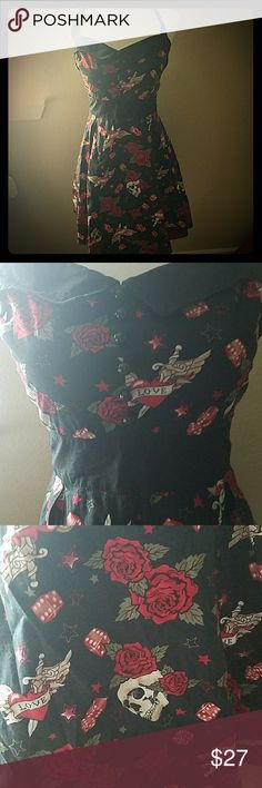 Rockabilly/ '50s Style Halter Dress, M Like new, worn one.  Hot Topic Brand. Zipper works, has all the buttons and no damage. Length is bit above the knee on me, 5'5. Pleated skirt that would look great with an under skirt.  Has skulls, roses, dice and love tattoos. Hot Topic Dresses Midi
