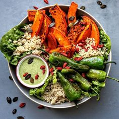 Roasted hokkaido, fried Pimientos de Padrón w/ garlic, quinoa, lettuces, goji berries served with a…