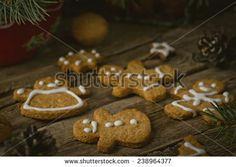 homemade ginger cookies on a wooden background with Christmas scenery. vintage style. selective focus - stock photo