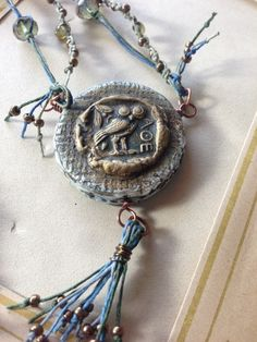Amazing waxed linen and handmade pendant - Tangled web - Athena and Arachne by Jenny Davies-Reazor.  It's reversible - visit the website to see the other beautiful side!