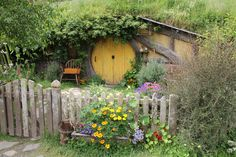 earth berm with picket fence - I just like this because it looks like a hobbit house :D