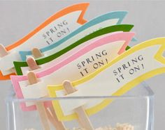 Green, yellow, pink, blue and orange.  Cake and cupcake toppers.  Spring.