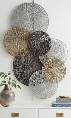A stunning work that seems to float airily across your wall the Adele Metal Wall Art is formed of laser-cut metal disks welded together forming a striking display. Each disk has a lacy delicately textured cut-out design inspired by natural elements. Metal Wall Art Decor, Metal Tree Wall Art, Gold Metal Wall Art, Modern Metal Wall Art, Contemporary Wall Decor, Silver Metal, Silver Glitter, Silver Wall Decor, Metallic Decor