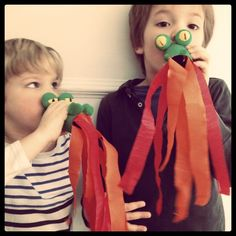 We made these fire breathing dragons, and it was a really fun project. There are several ways to make them. To make our version, you'll need the following:        cardboard toilet paper rolls      red and orange crepe paper      paint (green, yellow, black)      glue      wooden beads      mini green pompoms