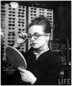Maeve Brennan trying on wooden framed glasses, 1945. Photo by Nina Leen for Life Magazine.
