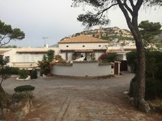 Lovely villa in Port Andratx, Majorca, with a view through the tall double doors to the bay behind.