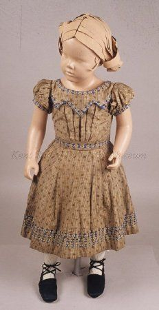 1855-1860 American light and dark brown silk stripe taffeta child's dress, wide neck, short sleeves, and full skirt with 3 rows of ribbon trim. Sash with large bow. Underblouse: white gauze, lace trim, green ribbon trim.