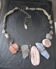Fossils in Spring- chunky necklace by Staci Louise Originals trilobite, kyanite, rough ruby, sea glass