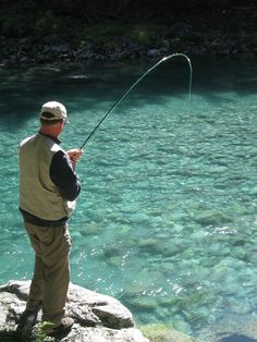 Fly fishing in the clear rivers of New Zealand's South Island