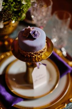 Purple and gold mini cakes. Sophie Sucree. Photography by timchin.com, Wedding Coordination by unity-weddings.com