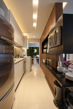A galley kitchen is a small compact cooking area that feature work spaces and appliances. A galley kitchen is often included in apartments and small homes New Kitchen, Kitchen Dining, Kitchen Decor, Kitchen Cabinets, Smart Kitchen, Kitchen Flooring, Kitchen Furniture, Kitchen Interior, Interior Desing