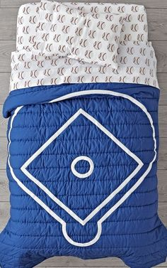 Shop Nod Baseball Toddler Bedding.  Our Nod Baseball Toddler Bedding is so great, it's ready to go pro.  Made from comfy 100% cotton, the baby quilt is uniquely designed to resemble a blue baseball diamond.