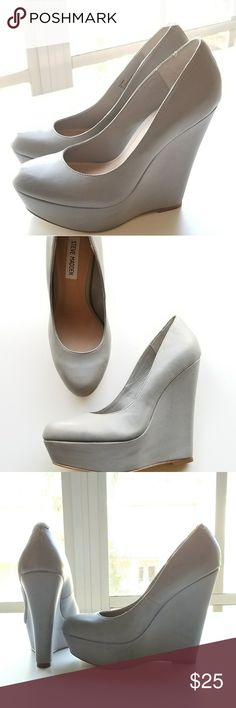 Steve Madden Grey Wedge Heels BRAND NEW AND NEVER WORN OUTSIDE!  These were the display pair at the store.  #SteveMadden #Grey #Wedges #size8 #sexyheels #5inchwedges #5inches  These Steve Madden wedges are in perfect condition and are extra sexy! I also am selling in Burgundy. Check out the rest of my closet for the listing! Fit true to size. Steve Madden Shoes Wedges