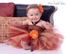 Autumn Princess Sunflower Baby Tutu Dress  She will be your little fall beauty in our Autumn Princess Sunflower dress! Our whimsical dress is made with a stretchy brown crochet top. Tutu skirt features soft tulle in pretty fall colors of Red, Chocolate, Yellow & Orange. Waist is adorned with a double chocolate satin & chiffon ribbon bow. We added a whimsical orange sunflower clip to waist. Sunflower is removeable, and she can wear as she grows