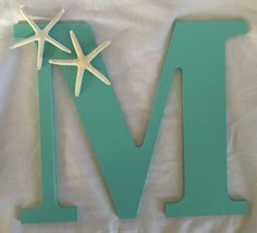 A personal favorite from my Etsy shop https://www.etsy.com/listing/219194417/letter-beach-wedding-wooden-letter-with