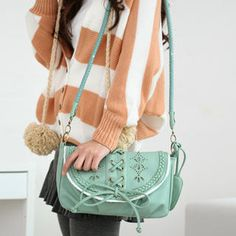 Buy '59 Seconds – Perforated Detail Crossbody Bag' at YesStyle.com plus more Hong Kong items and get Free International Shipping on qualifying orders.