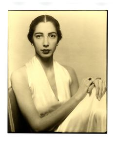 Black and white photograph of Harriet Bath in white, 1937