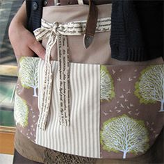 Gardening aprons are ideal for grooming aprons with lots of pockets and they can be very cute like this one from Etsy.com.