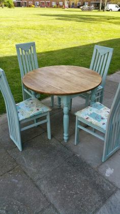 Pale duck egg folding farmhouse table with high back dining chairs.