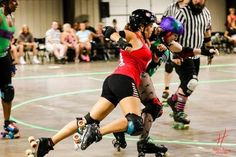 This is me, Hot Body Yadi, initiating a block against Alicia Verasammy in our debut with The Yellow Rose Derby Girls. She and I were both fresh meats together and we were drafted on the same day to our respective home teams, Las Chupacabras and the Rattlesnake Ruckus. Photo credit: Hung L. Truong Photography Roller derby blocking