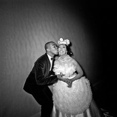 """Josephine Baker getting a little kiss from Geoffrey Holder in 1964. I'm guessing this is probably backstage at """"Josephine Baker And Her Company,"""" her musical revue that appreared briefly on Broadway that year. Both Mr. Holder and his wife Carmen de Lavallade performed in the show with Ms. Baker and, in the video clip linked in the comment section, Mr. Holder discusses, with his signature verve, what a delight it was for he and Ms. de Lavallade to work with Ms. Baker. Photo: Mic"""