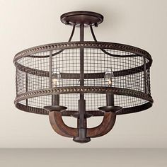 Add dimension to your home with this handsome ceiling light. Industrial inspired, this lighting fixture features a mesh shade and a distinguished bronze finish.