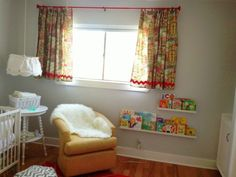 Baby T's Nursery, from You Frill Me blog  www.youfrillme.com    with Ikea picture ledges used as bookshelves