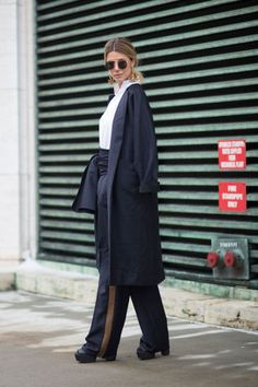 Navy blue belted pants with a long draped coat  | For more style inspiration visit 40plusstyle.com