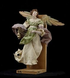 Angel  Attributed to Giuseppe Sanmartino  (Italian, 1720–1793)  18th century Culture: Italian (Naples) Medium: Polychromed terracotta head; wooden limbs and wings; body of wire wrapped in tow; various fabrics. Dimensions: H. 15 3/4 in. (40 cm.)