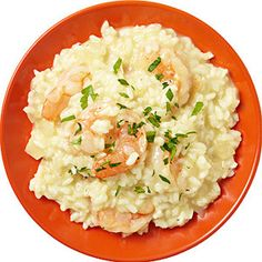 Risotto With Shrimp - extra virgin olive oil - medium onion - Arborio rice - freshly ground black pepper - 4 cups reduced sodium chicken broth - uncooked shrimp - butter - lemon
