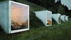 "Switzerland's Peter Kunz Architektur is responsible for the creation of a modern day ""Batcave""-style garage."