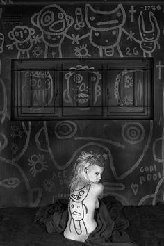 Roger Ballen.    Gooi rooi, Newspaper scene, Pielie, and Ninja, 2012, Archival pigment prints