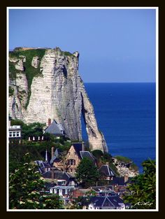 Room with a view - Etretat, Haute-Normandie.  Étretat is a commune in the Seine-Maritime department in the Haute-Normandie region in northern France. It is a tourist and farming town situated about 32 km (20 mi) northeast of Le Havre, at the junction of the D940, D11 and D139 roads. It's located on the coast of the Pays de Caux area.