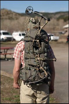 Mystery Ranch Longbow pack with a compound This bag is one of the best. You can also atach a gun, like Ruger 10/22 to the side of the bag.