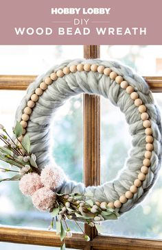 Create a whimsical winter wreath with wood beads, yarn, and floral stems.