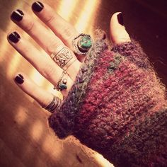 Black nails, cozy knit with thumbhole and boho rings.