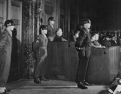 Security guards from the 26th Infantry Regiment, 1st Infantry Division Medical Trial, stand guard at a Military Tribunal, February 28, 1947, at the Nazi War Crimes Trials in Nuremburg, Germany.