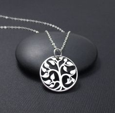Simple but Beautiful Sterling Silver Tree Of Life Charm Pendant Necklace. The pendant measures 7/8 high including the ring or 3/4 (20mm in diameter). It is attached to a delicate 1.3mm sterling silver flat cable chain with a permanently closed ring. The chain features a sterling silver spring ring clasp closure and it is .925 hallmarked. Chain lengths: 16,18 or 20. The wire and all other metal components on this necklace are all solid .925 sterling silver as well. Gift box included. Link to…