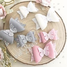 Butterfly hair bow Material: The bow is made from chunky glitter fabric 100% wool felt and finished with faux pearls. Choice of sizes: 🎀 Small 5.5cm 🎀 Large double layer 8cm Choice of colours: 🎀 Pink 🎀 Grey 🎀 White 🎀 Or choose a CUSTOM colour. Please refer to the colour charts and