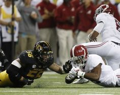 Alabama running back T.J. Yeldon (4) recovers a fumbled ball as Missouri defensive lineman Shane Ray (56) looks on during the first half of the Southeastern Conference championship NCAA college football game, Saturday, Dec. 6, 2014, in Atlanta. (AP Photo/Brynn Anderson)