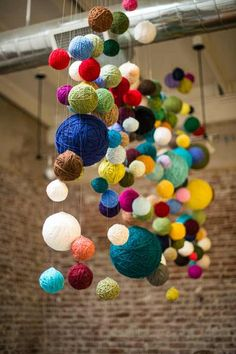 yarn balls hanging from ceiling, could do above table in lieu of a centerpiece