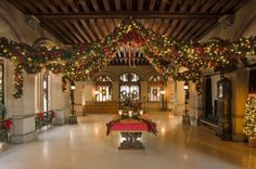 Entry Hall at Biltmore House decked out in holiday greenery. [Photo: The Biltmore Company]