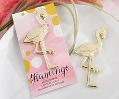"Pretty in pink--or gold!--Kate Aspen's ""Fancy and Feathered"" Flamingo Bottle Opener stands tall above other party favors. Full of whimsy and mod chic, this fun and functional party favor will definite"