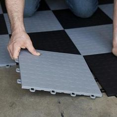 make tiles out of rubber mats from Sheps bush and Harrow Road. Great for the garage and store rooms.