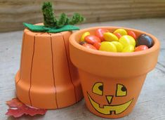 Terra Cotta Pumpkin Pots: These cute pots are great as a table decoration, or turned upside down they make fun treat holders. Provide the paint and markers at your Halloween or harvest party, and this makes a great project for your guests. Halloween Crafts For Kids, Easy Halloween, Holidays Halloween, Halloween Pumpkins, Holiday Crafts, Holiday Fun, Kids Crafts, Halloween Decorations, Halloween Centerpieces