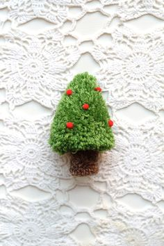 Don't have a tree? Try this Christmas Tree pom pom tutorial by one sheepish girl.