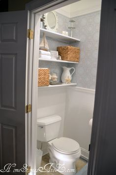 Beach-y keen decor in this well stocked powder room!