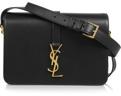 Saint Laurent's 'Monogramme Sac Université' shoulder bag is timeless. It's made from smooth leather and embellished with the brand's heritage 'YSL' plaque. A wide shoulder strap makes it comfortable to carry throughout the day. Shop it now at NET-A-PORTER Classic Handbags, New Handbags, Black Handbags, Fashion Handbags, Ladies Handbags, Shoulder Strap Bag, Black Shoulder Bag, Leather Shoulder Bag, Leather Purses