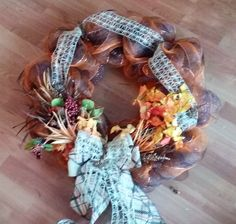 Brown and orange deco mesh with net burlap ribbon just make this an awesome fall wreath!