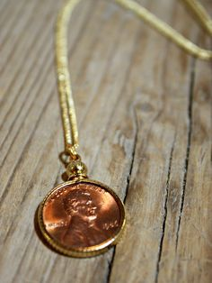 """Make every day lucky with this penny necklace.  Brass chain measures 18"""" with a gold finish.  Custom orders available for additional years.  Please e-mail for inquiries."""
